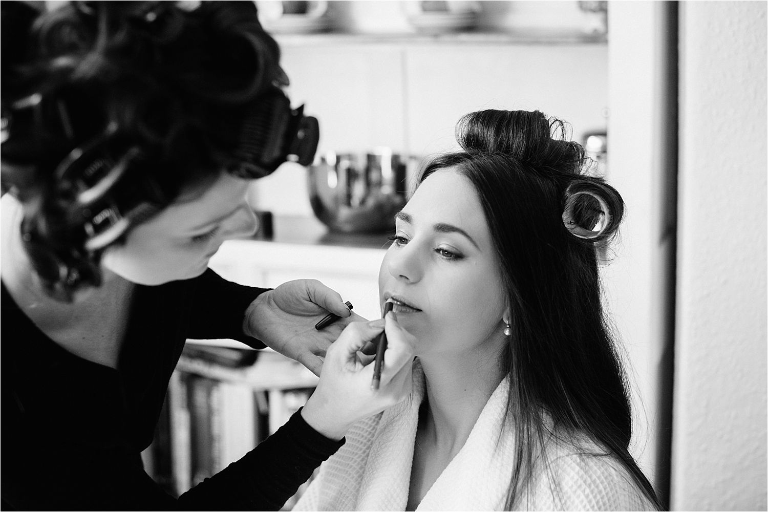 Final touches to make up for bride prior to her Cheshire wedding
