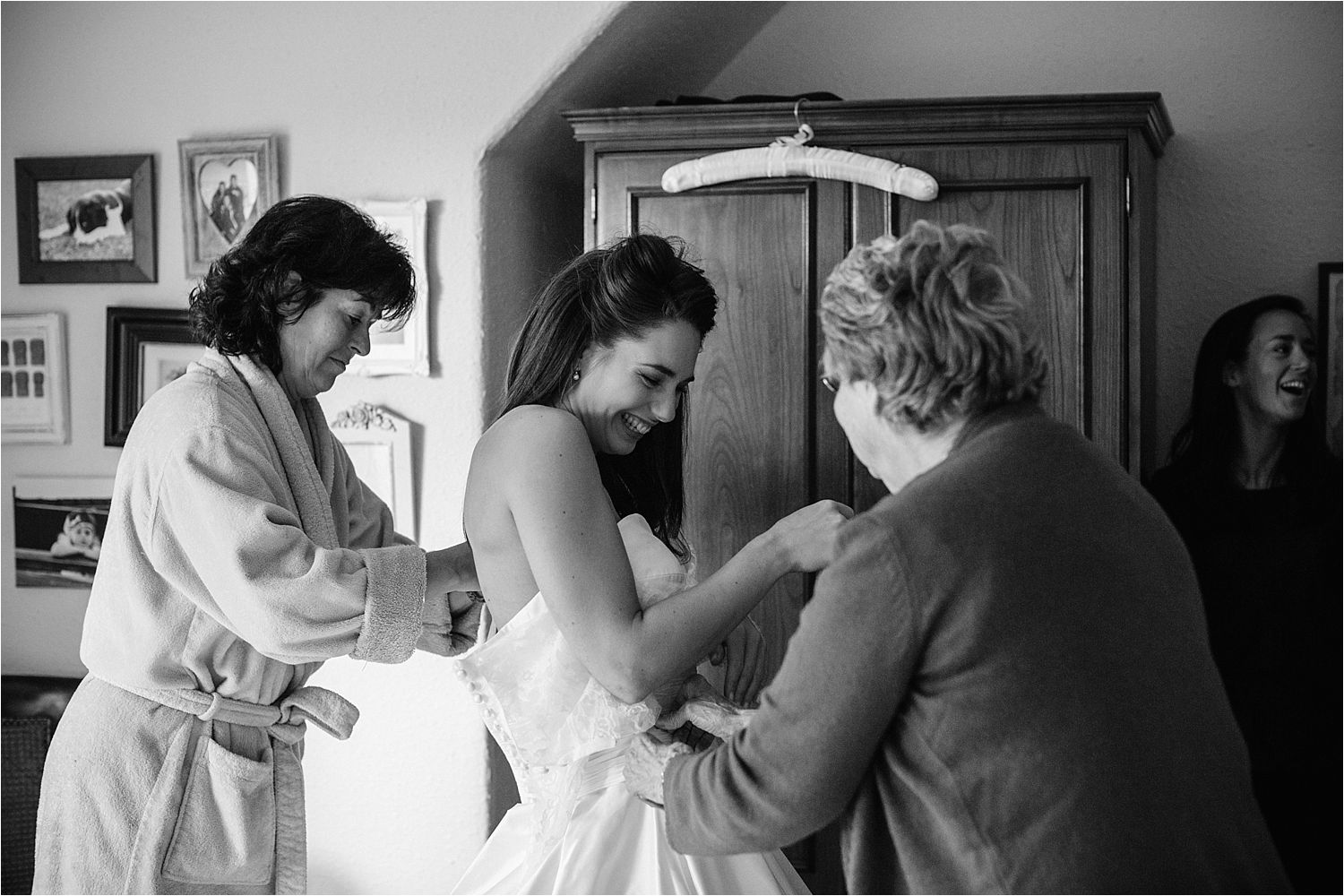 Bride being fitted into her wedding dress before her  Cheshire wedding at Hilltop Country House