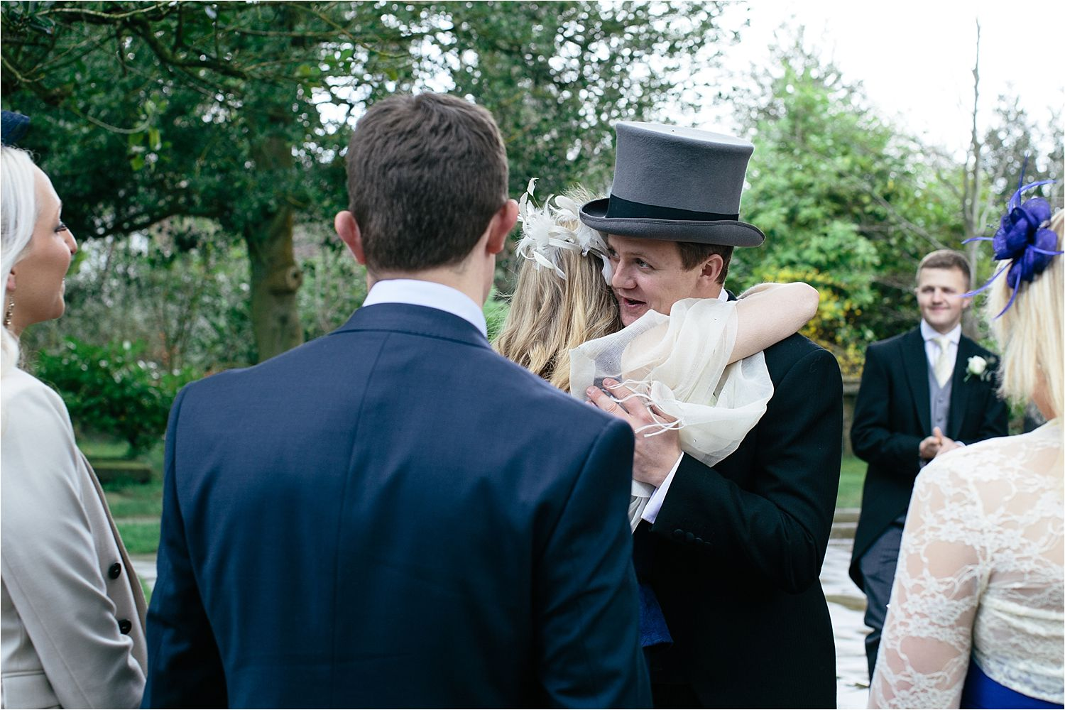 The bridegroom greets his guests outside the church in Prestbury