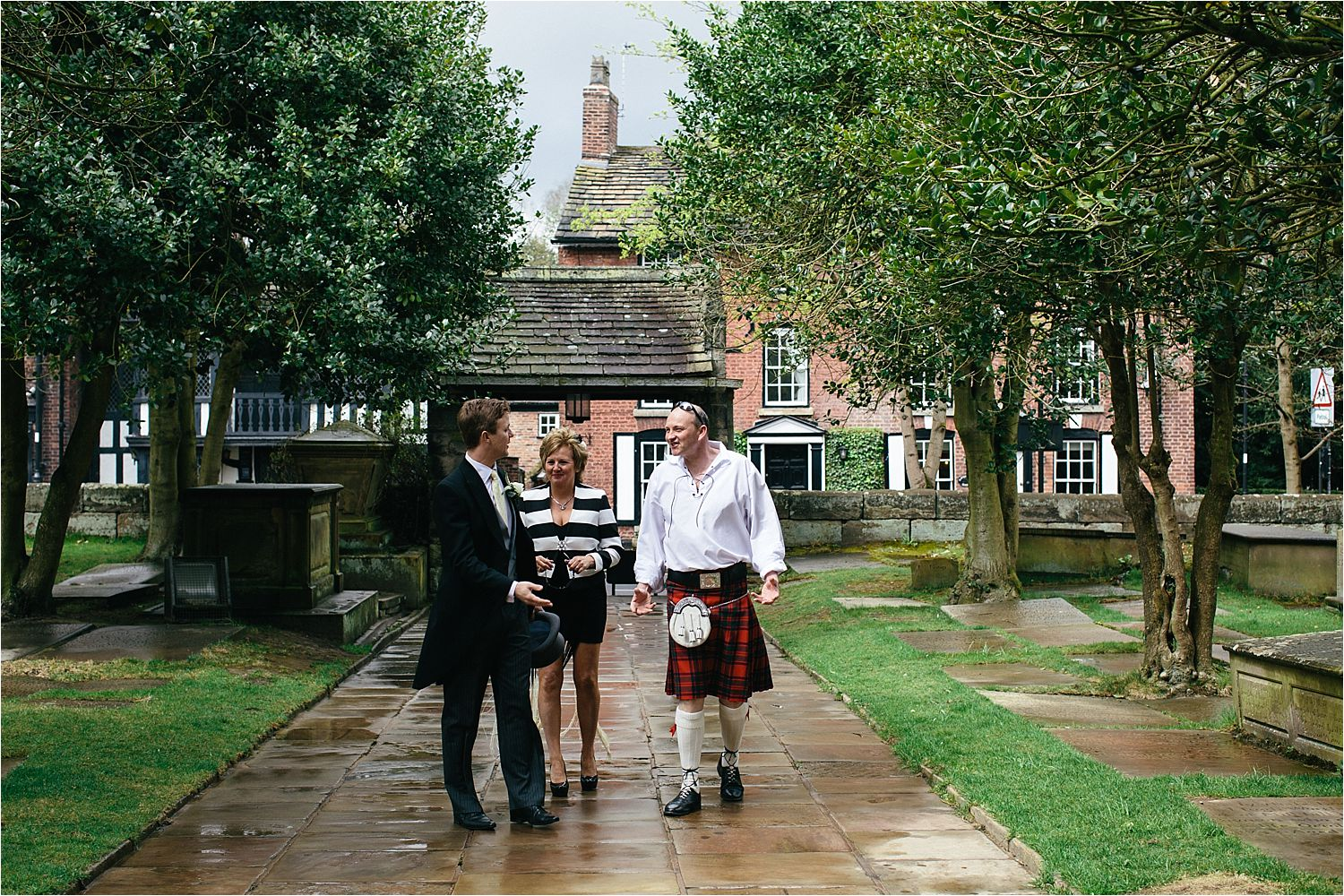 Kilt wearing wedding guest arrives at church for Cheshire wedding
