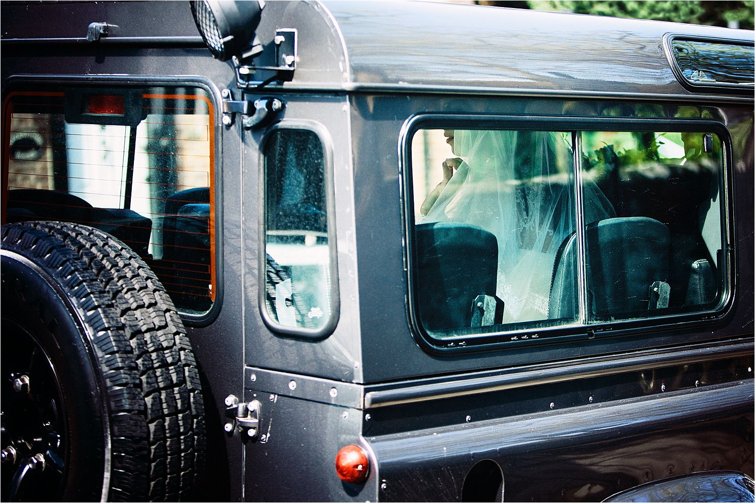 Cheshire bride arrives at church in Landrover Defender