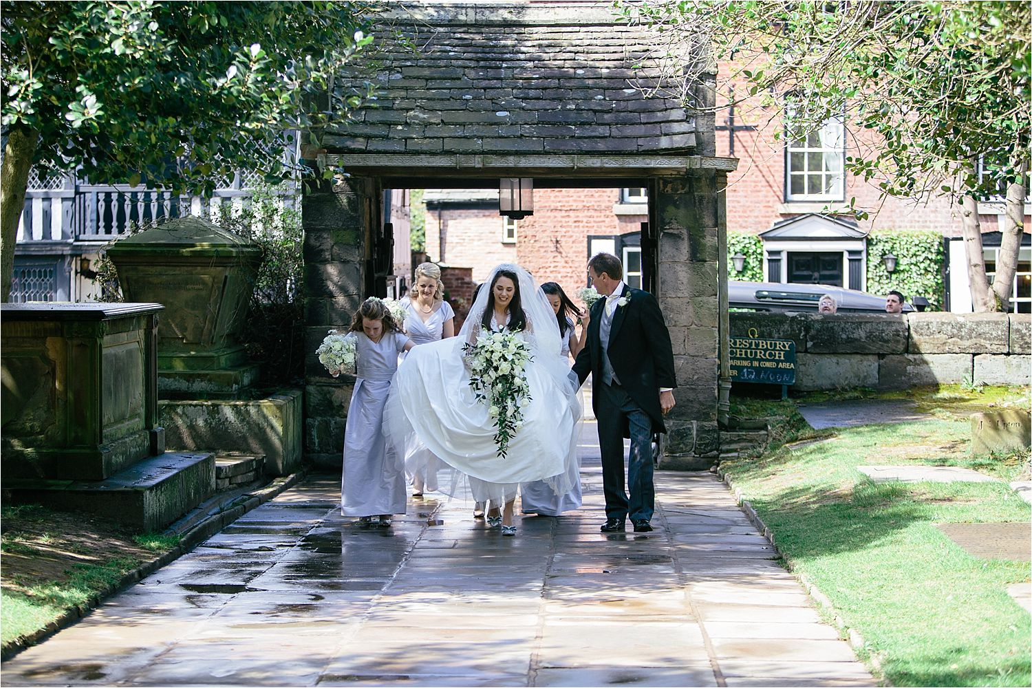 Bride and Bridesmaids walking up the path to Cheshire church