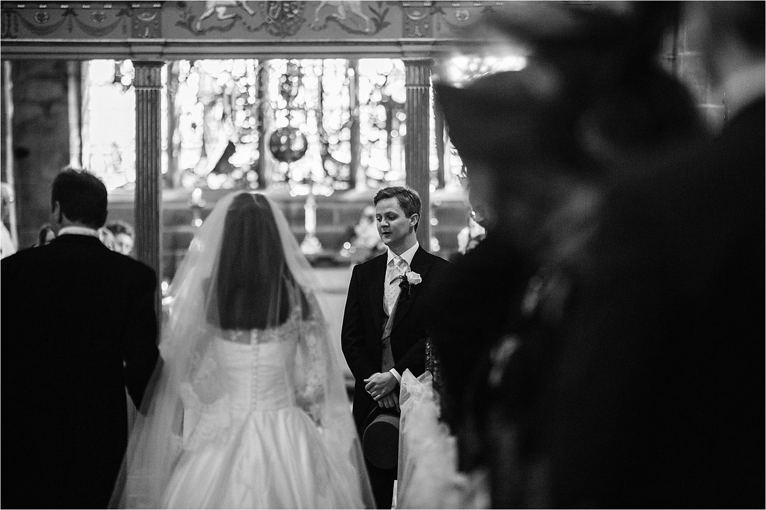 Bridegroom waits pensively for his bride in St Peter's church Prestbury