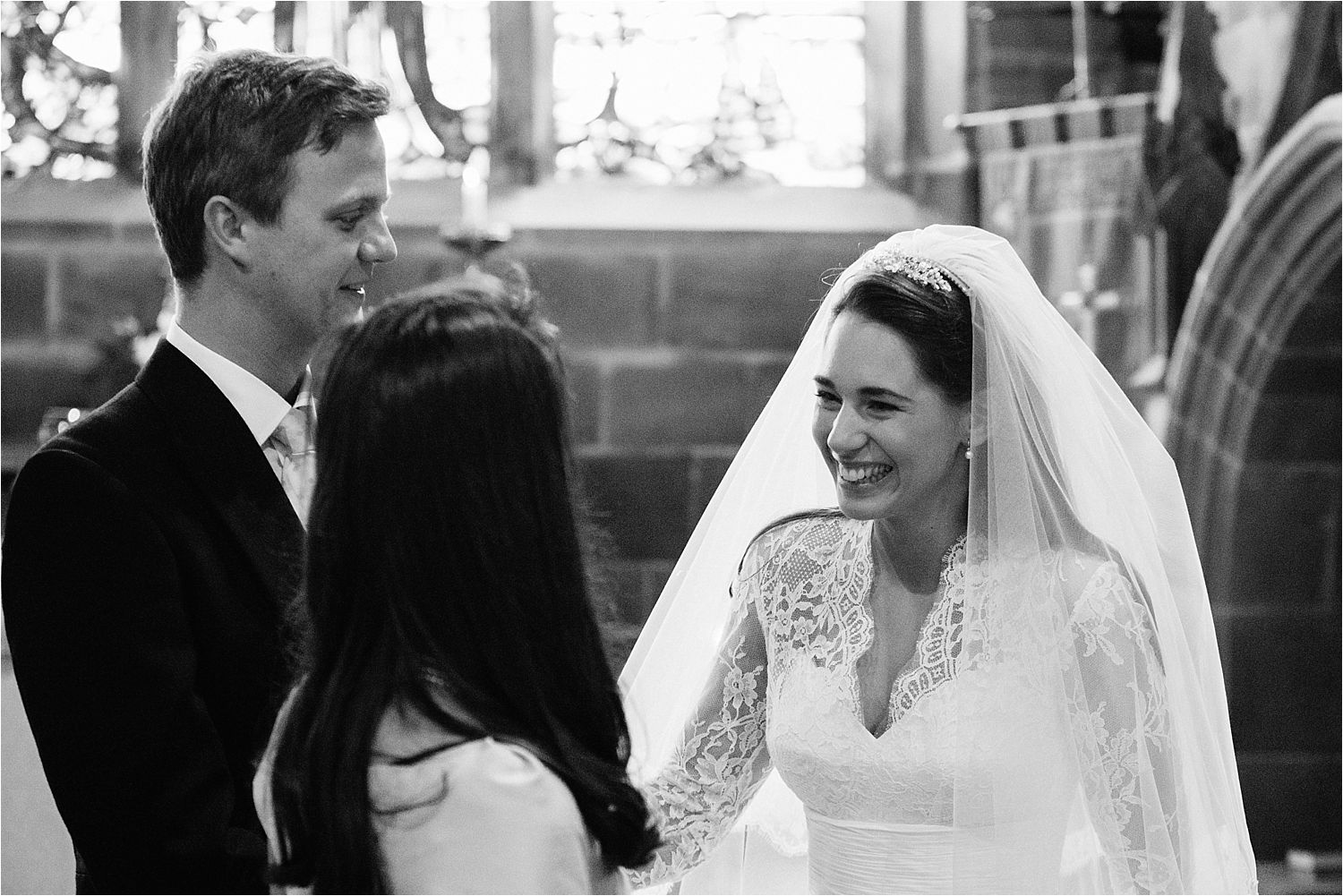 Bride in a happy moment at the signing of the register in Cheshire