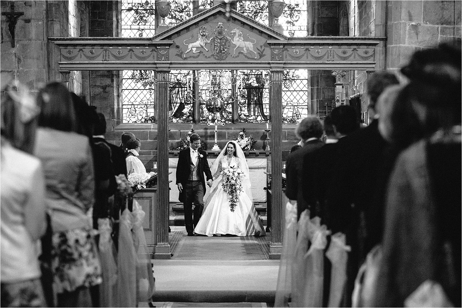 Bride and groom walking down the aisle after their Cheshire wedding in Prestbury