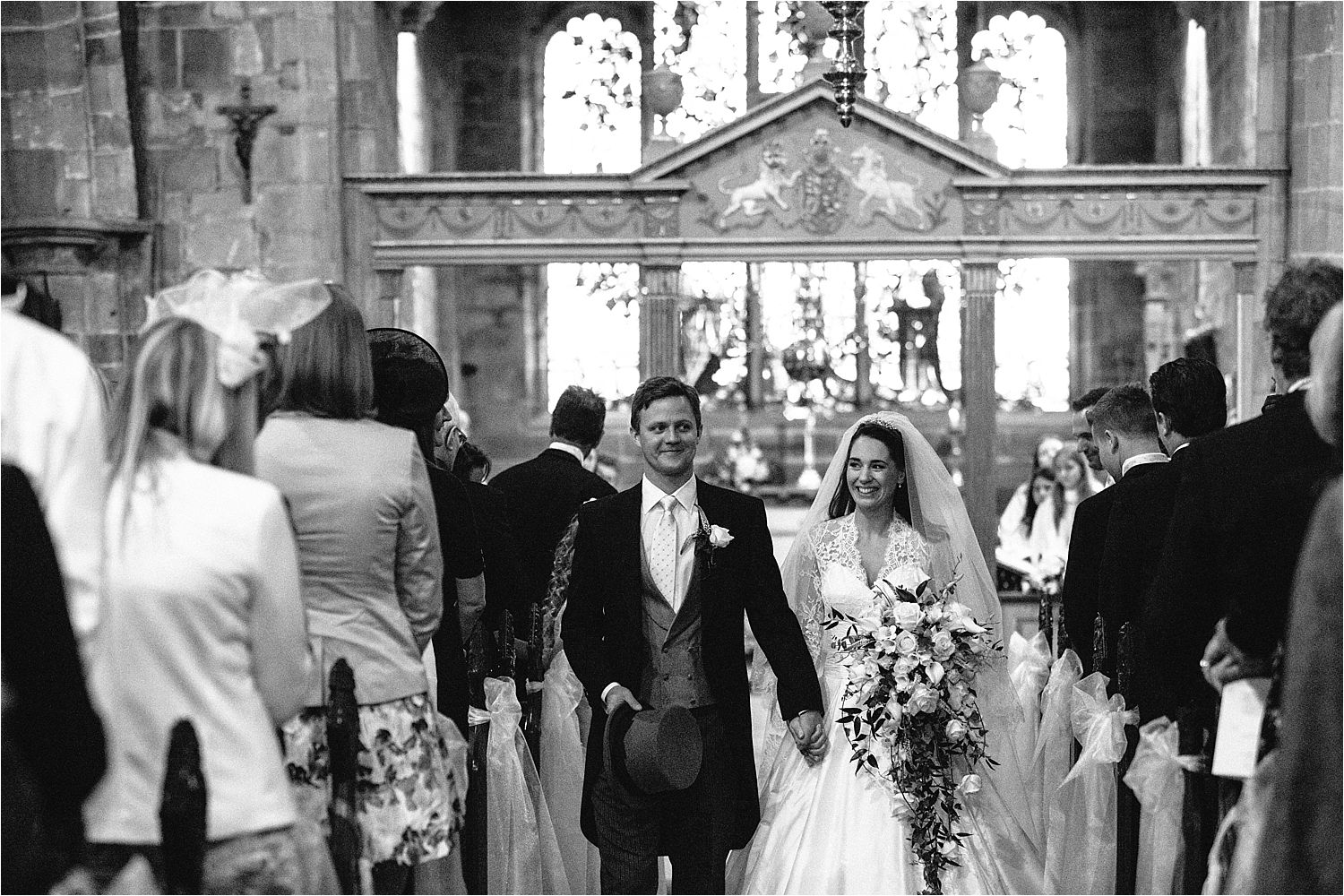 Relaxed bride and groom walking down the aisle after their wedding ceremony in Prestbury