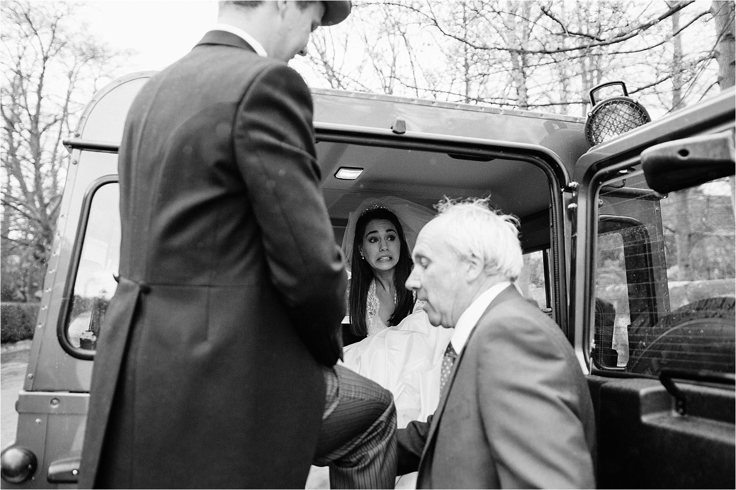 Bride and groom step into Landrover Defender for journey to their reception at Hilltop Country House in Cheshire