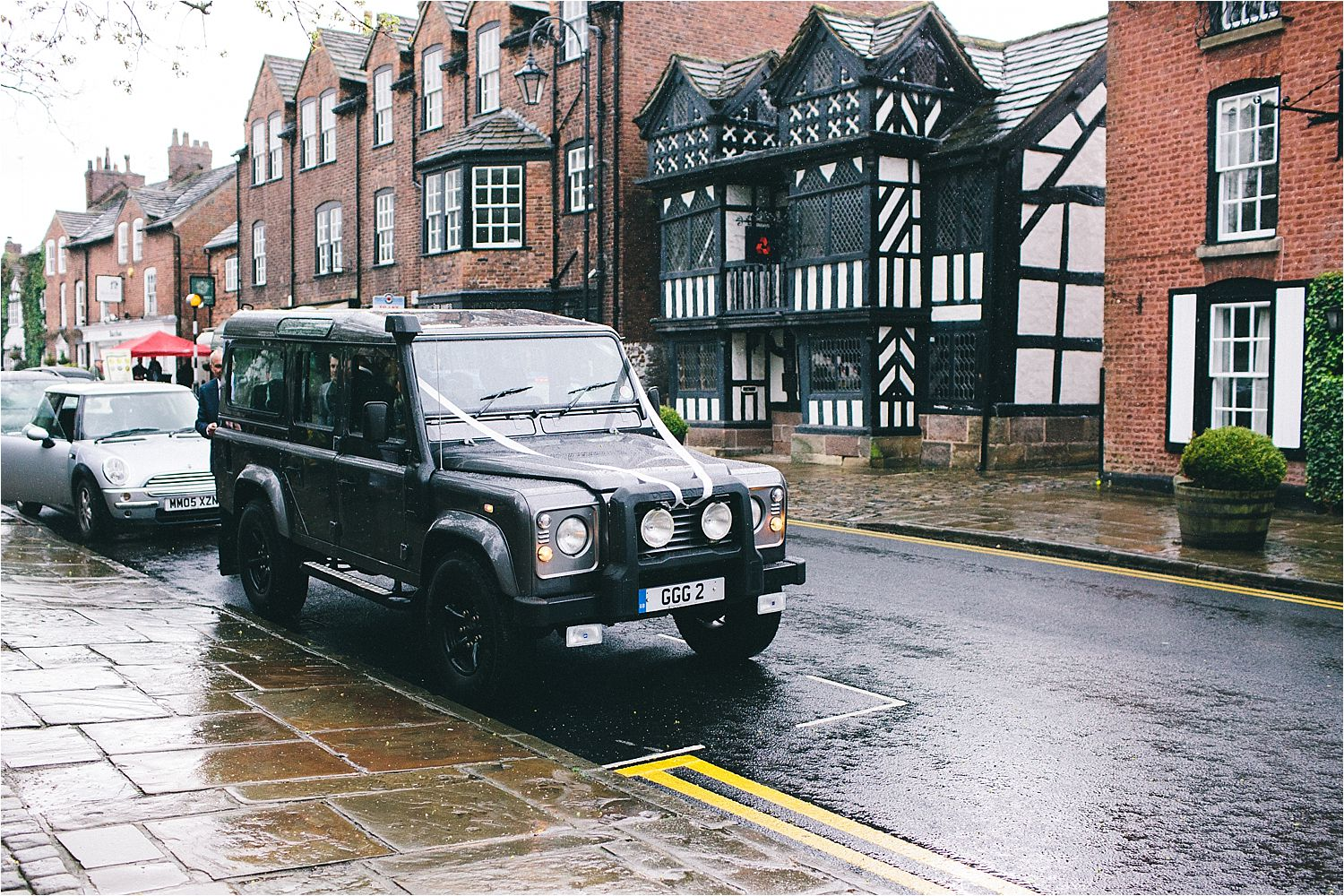 Landrover Defender waiting for bride and groom in Prestbury Cheshire