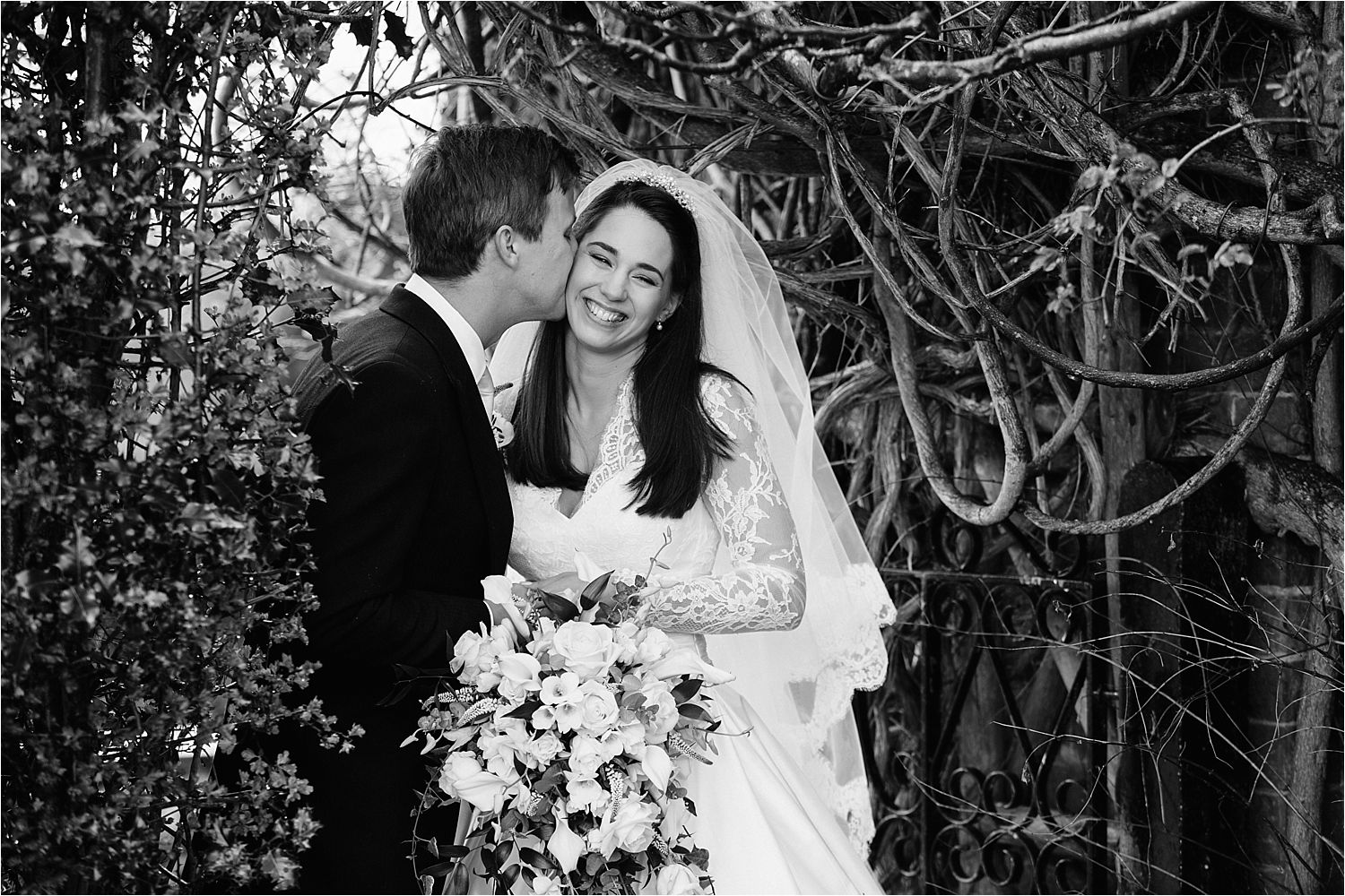 Bridegroom kisses his bride at their Hilltop Country House wedding reception