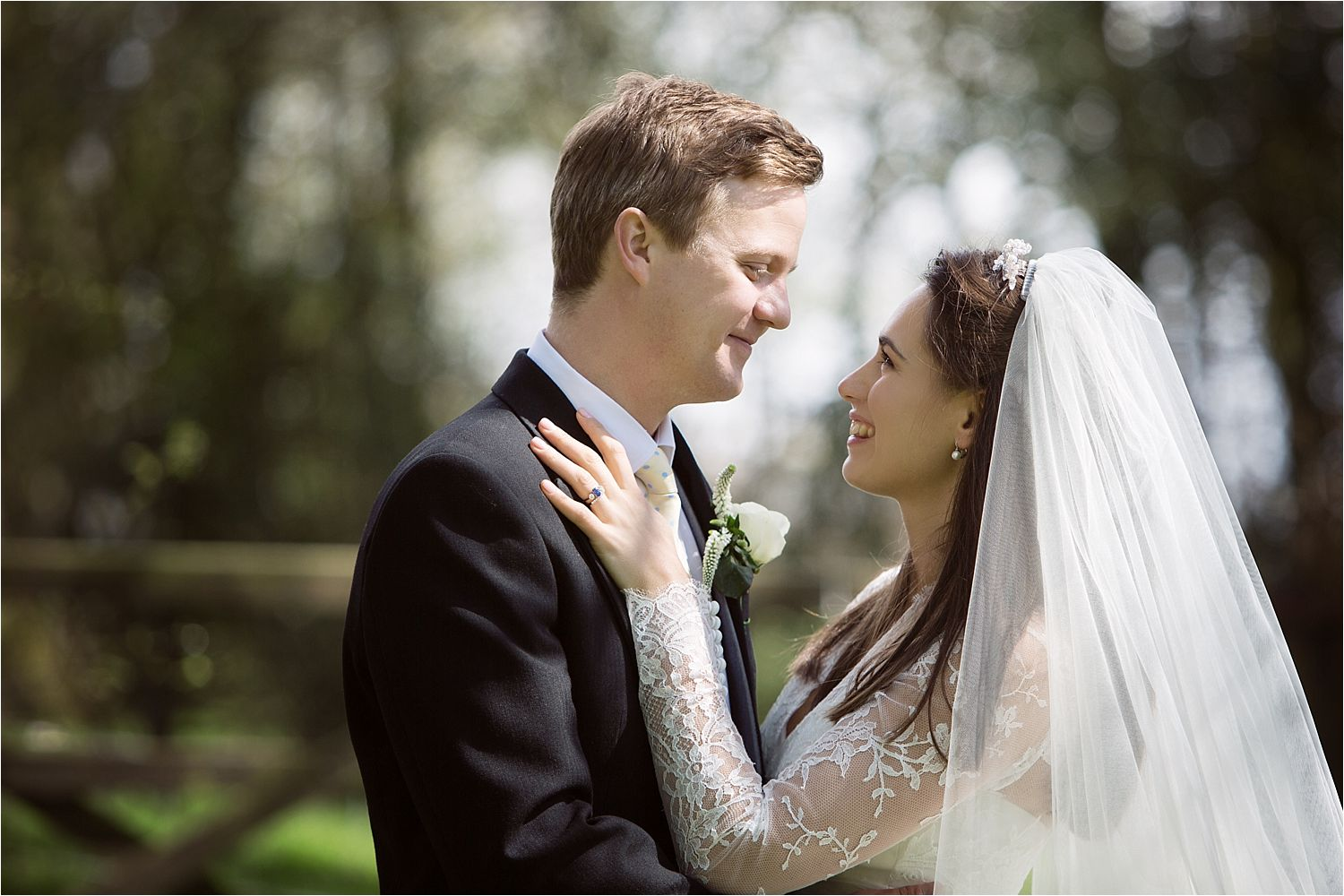 Bride and groom share an intimate moment together before their Hilltop Country House wedding reception