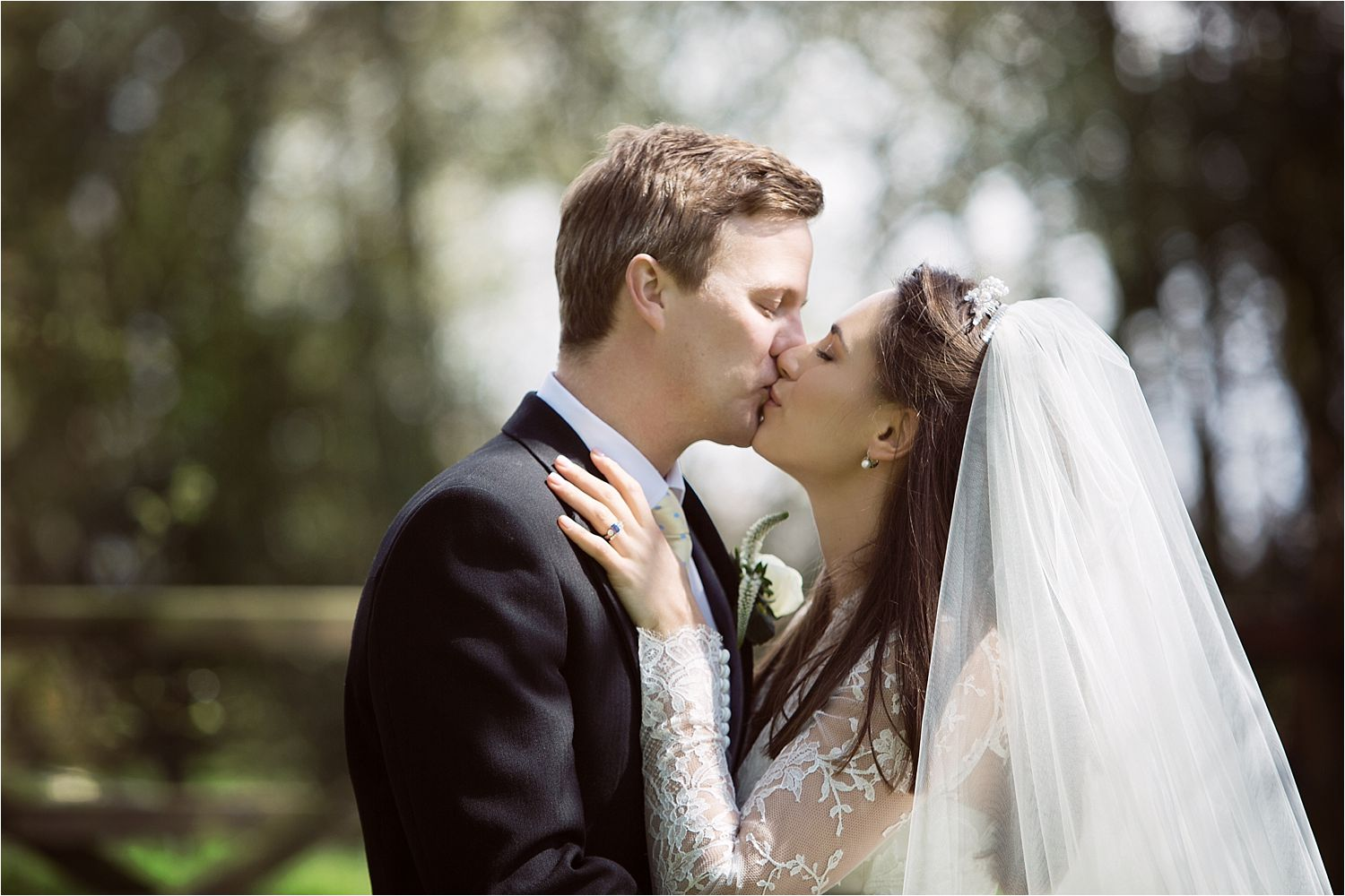 Bride and groom kissing in the gardens of Hilltop Country House