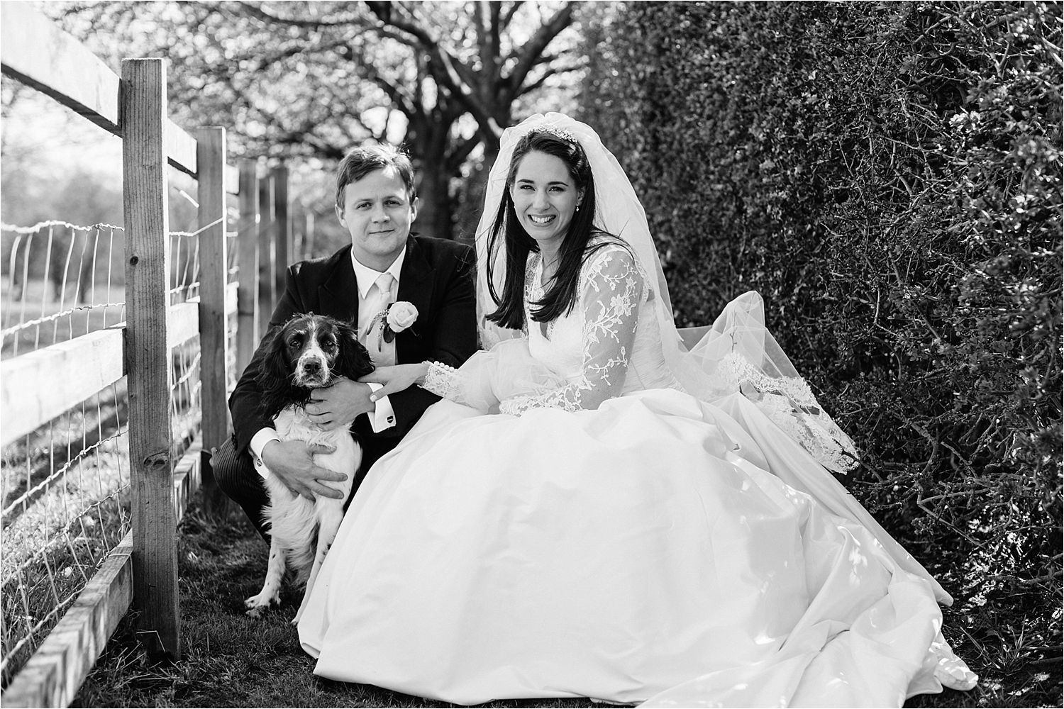 Bride and groom and their cocker spaniel at Cheshire wedding