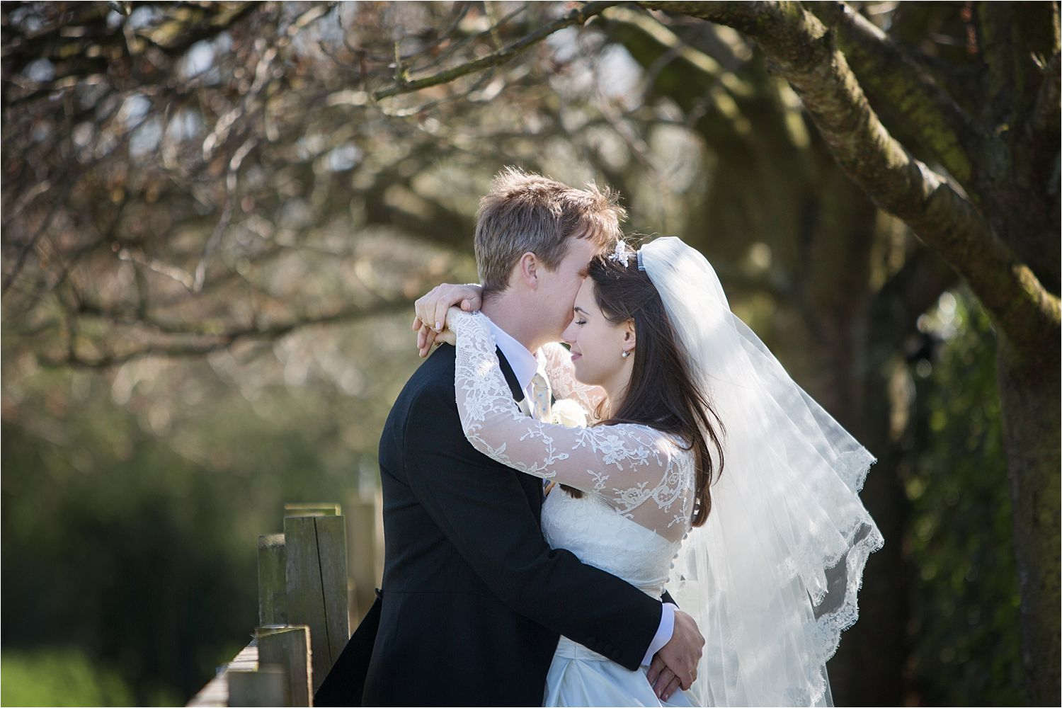 wedding couple embrace in the gardens of Hilltop Country House in Cheshire