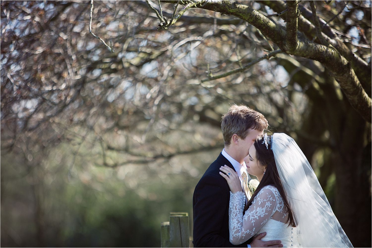 Bride and groom embrace in the gardens of Hilltop Country House