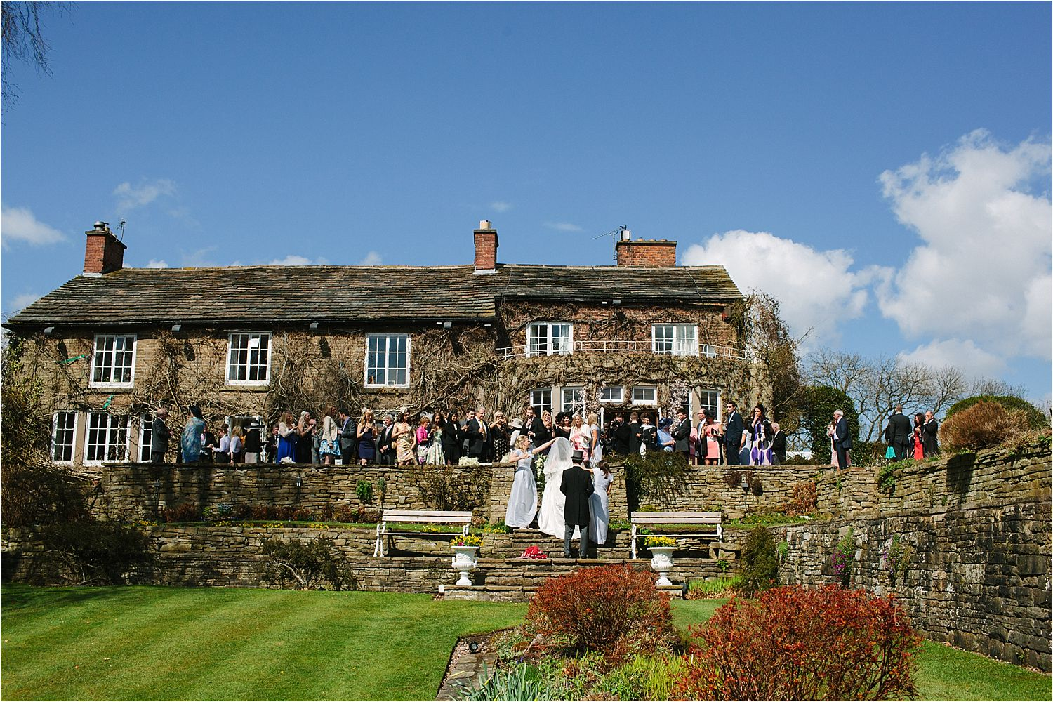 Bride, groom and their guests at Hilltop Country House in Cheshire
