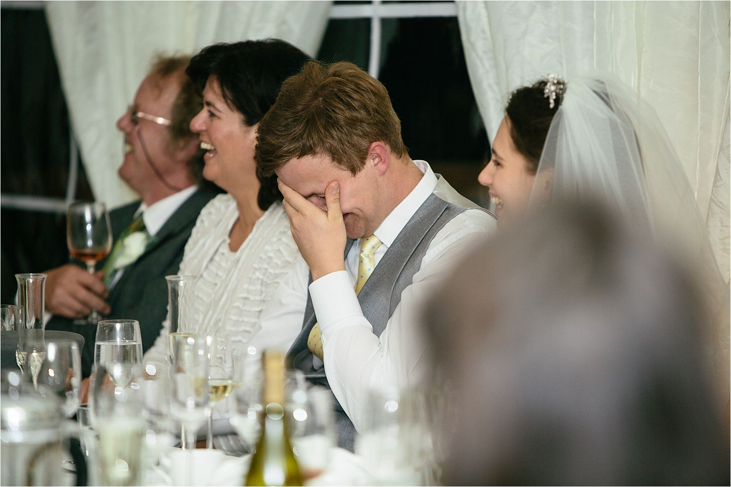 Bridegroom, head in hands as he listens to best man's speech at his  Hilltop Country House wedding