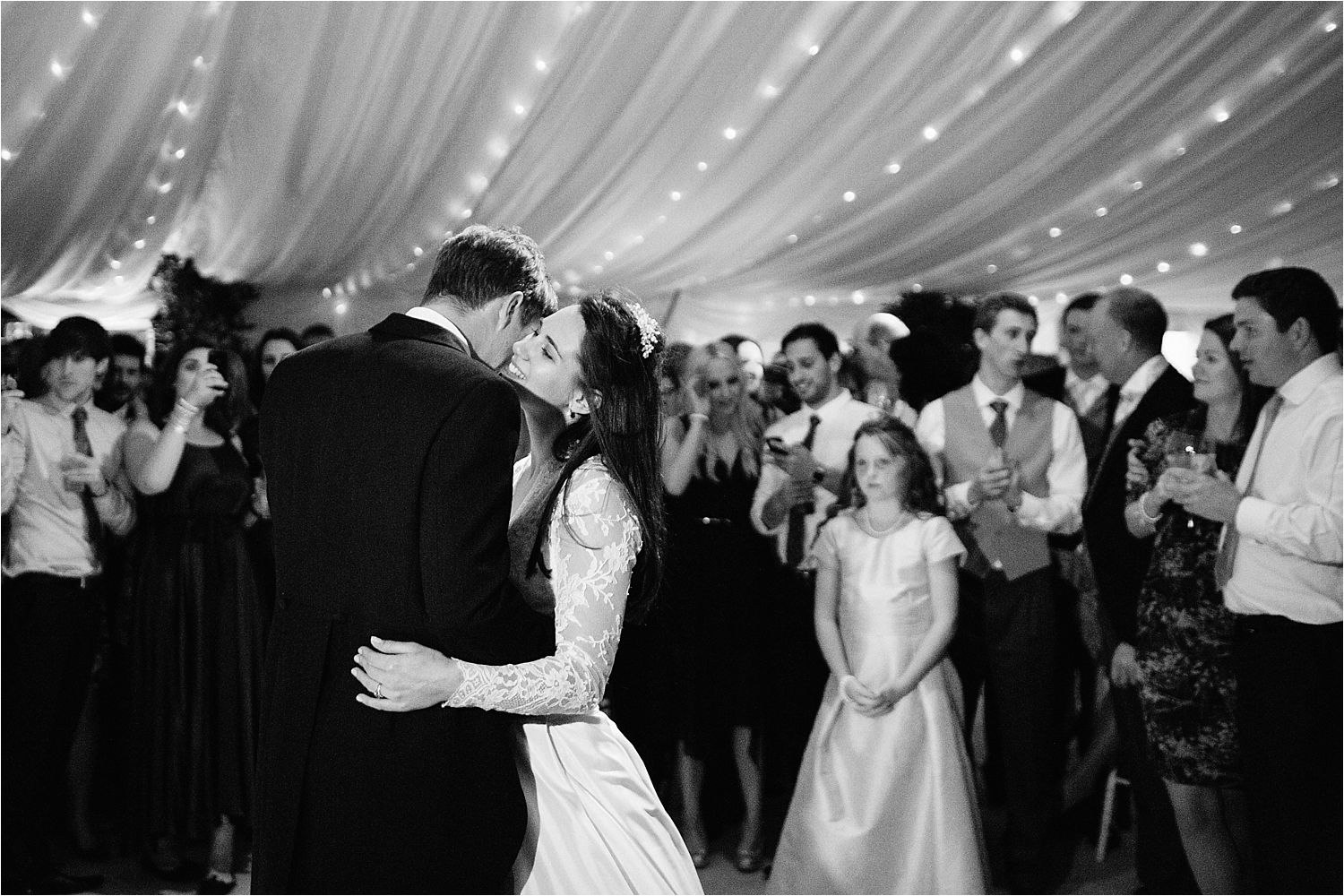 Wedding guests enjoy the bride and groom's first dance at Cheshire marquee wedding