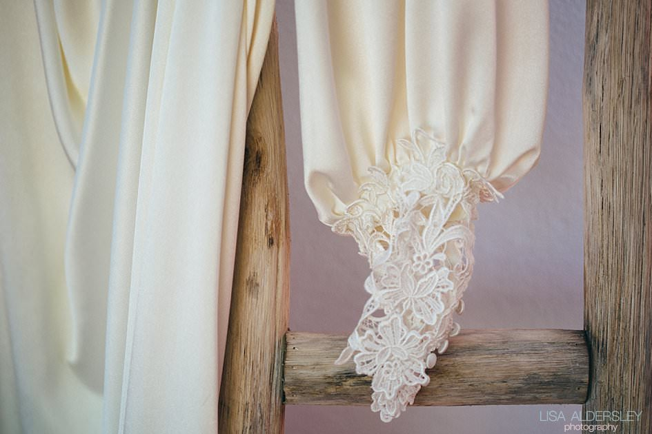 Lace sleeve on a Charlie Brear wedding dress