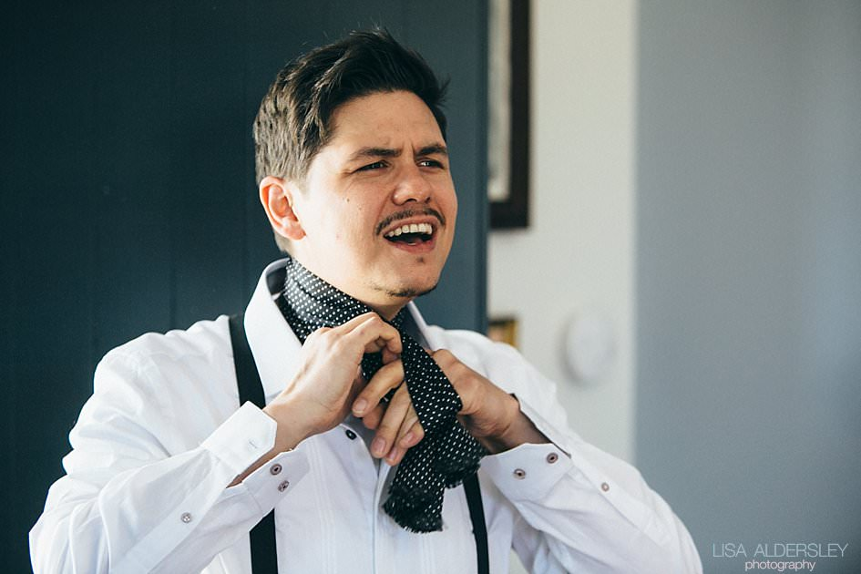 Groom tying his cravat