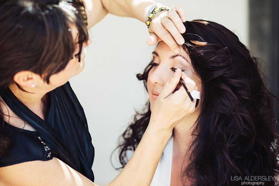 Bride having eyeliner applied by a make up artist