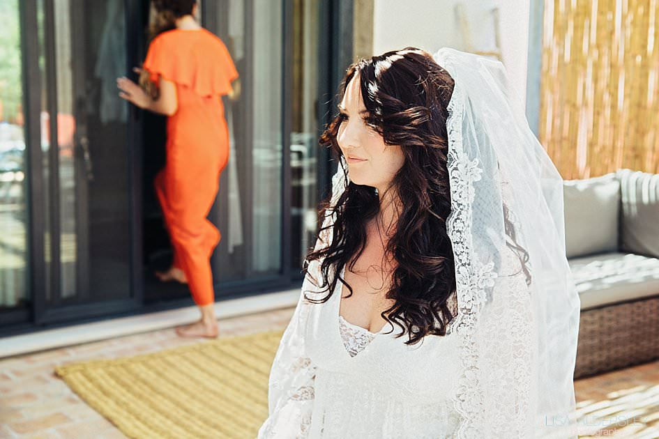 Bride smiling at her reflection in the mirror