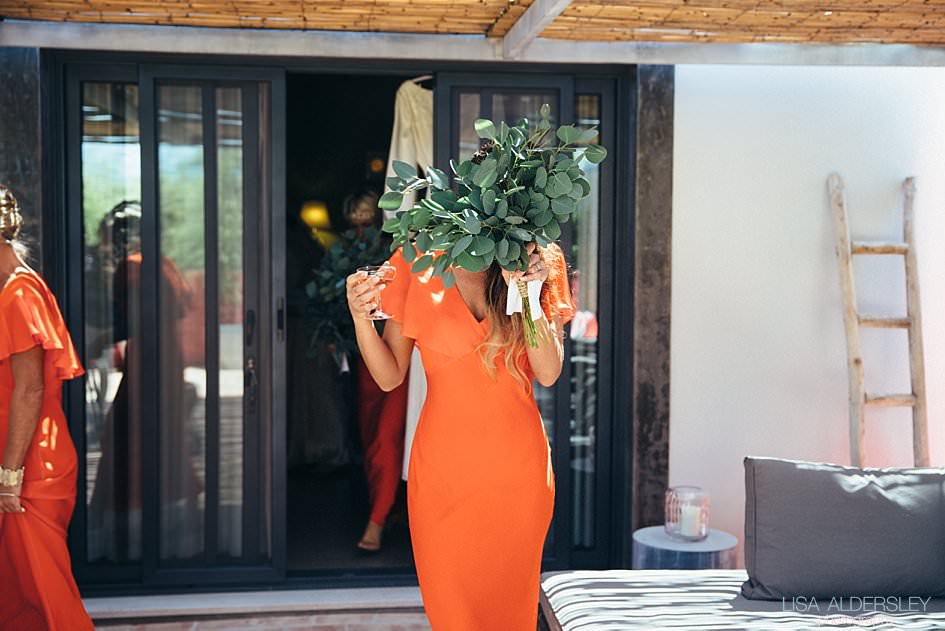 Bridesmaid hiding behind a bouquet of eucalyptus