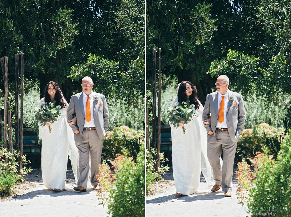 Bride and her dad walking up the aisle to the ceremony