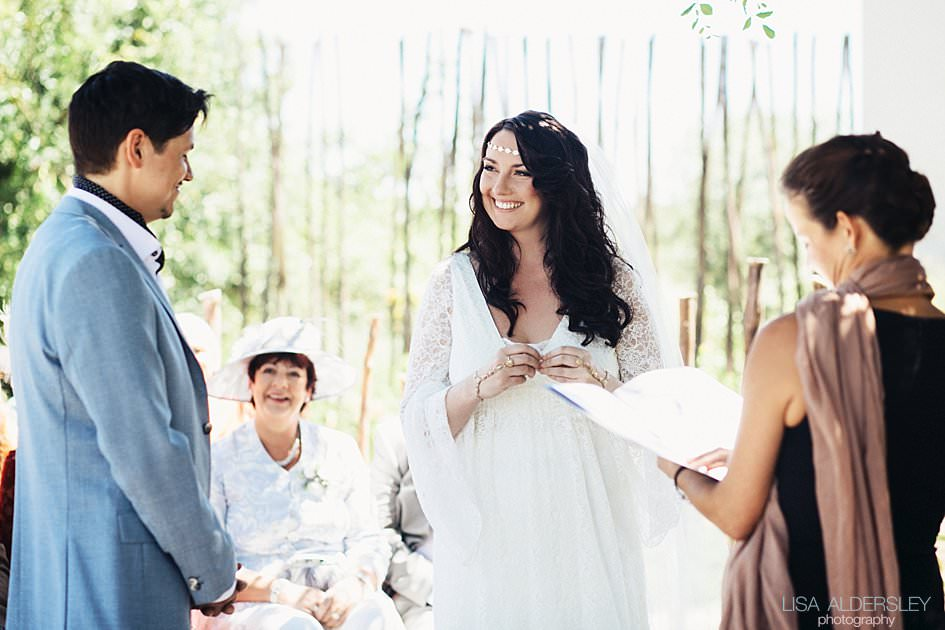 Bride smiling at her husband during the wedding vows