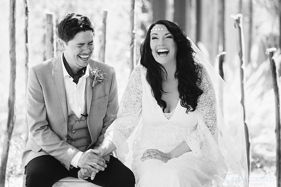 Bride and groom holding hands and laughing out loud