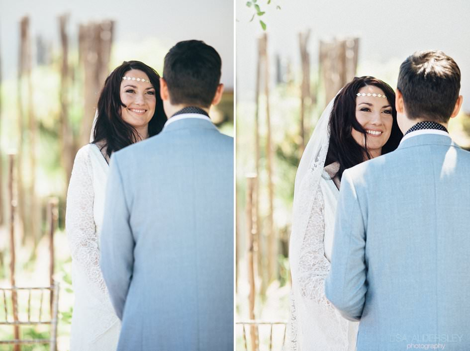 Bride smiling at her husband to be as he says his vows to her