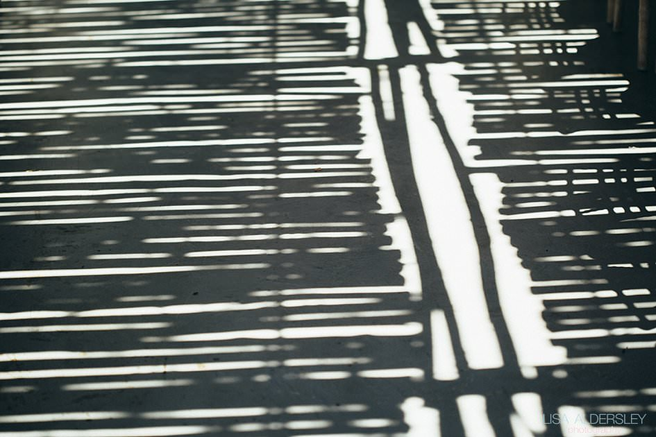 Reflection of the willow screens on the concrete floor