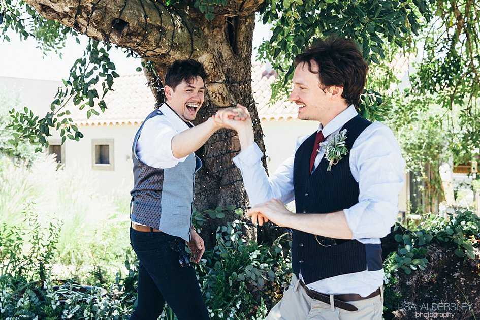 Best man and groom dancing together