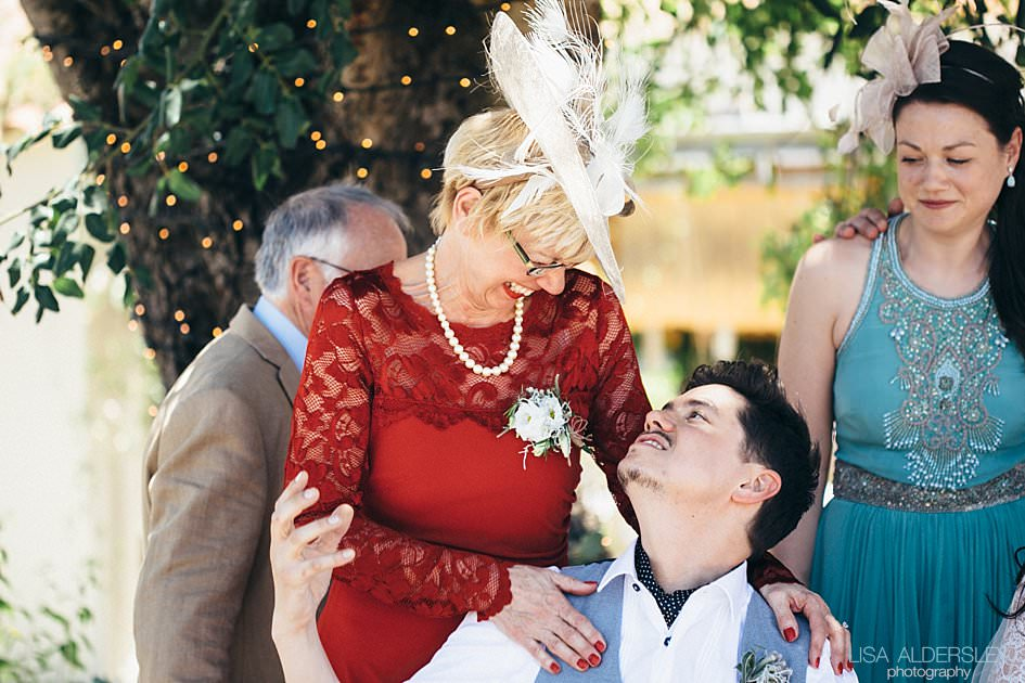 Groom and his mum having a laugh together