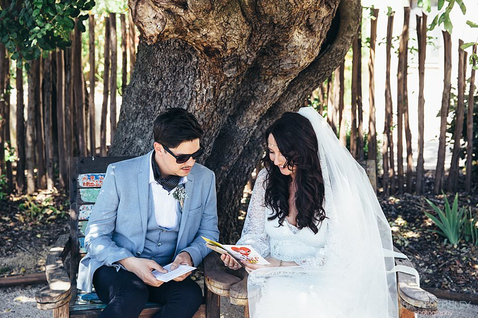 bride and groom reading their wedding cards to each other