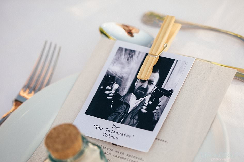 Polaroid photographs pegged to menus used as place settings