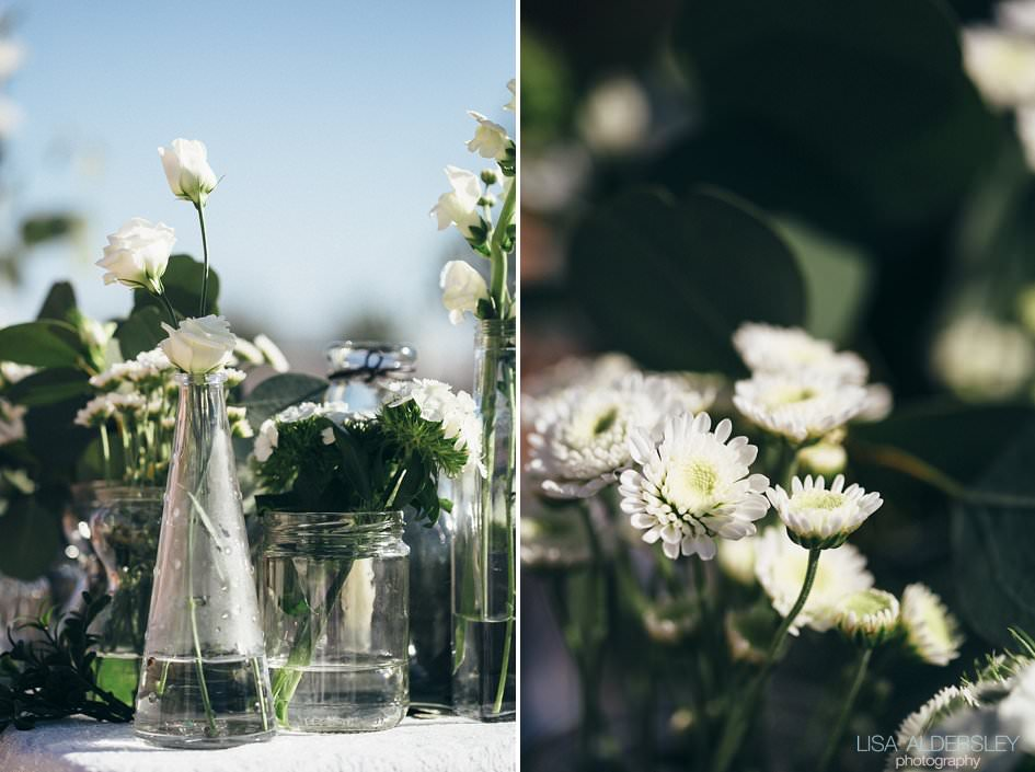Jars of flowers on the table set for the wedding breakfast