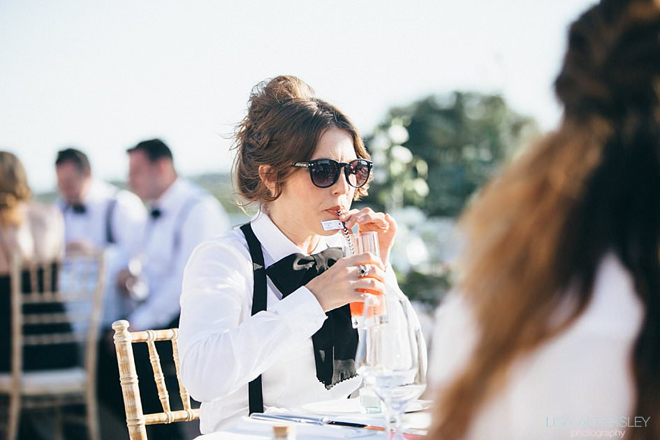 Bridemaid drinking pimms through a straw