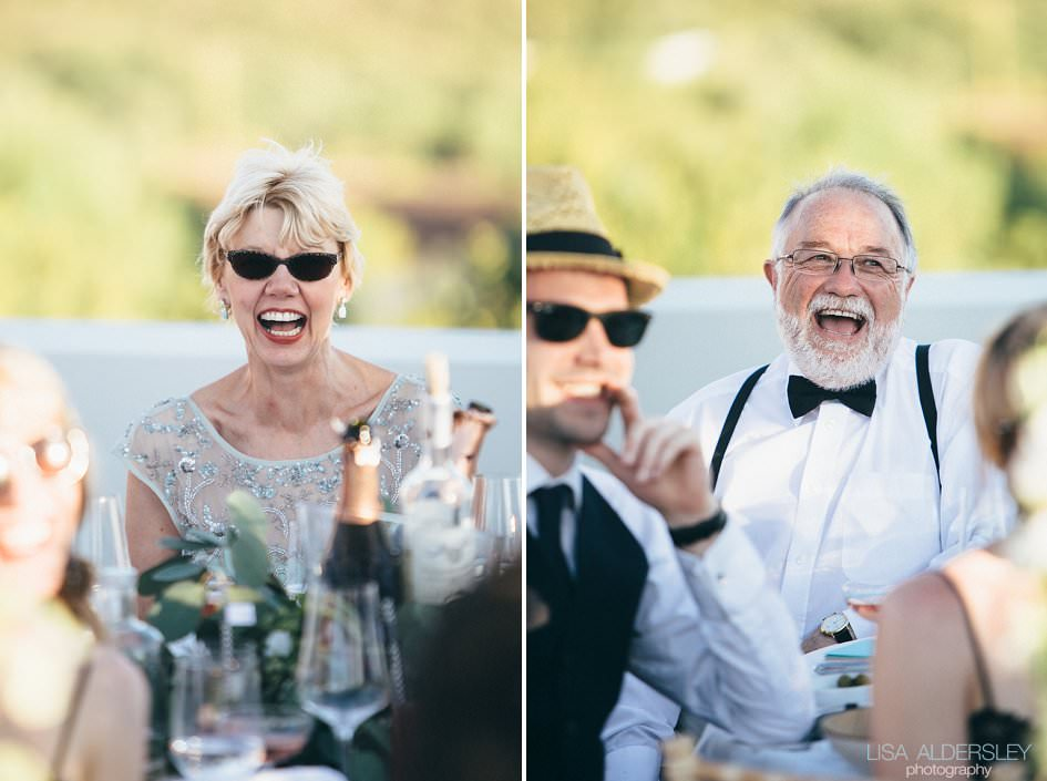Guests laughing at the brides father's speech