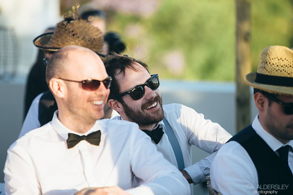 Guests laughing at the grooms speech