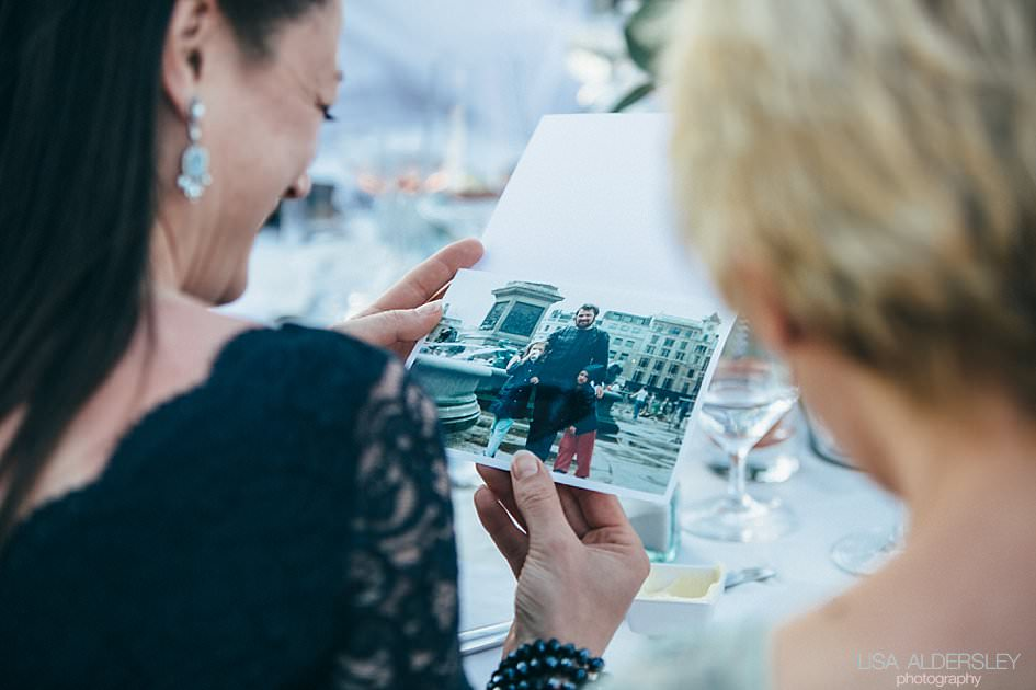 Guests looking at old photographs of the groom