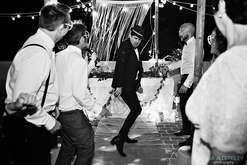 Groom dancing at the wedding reception