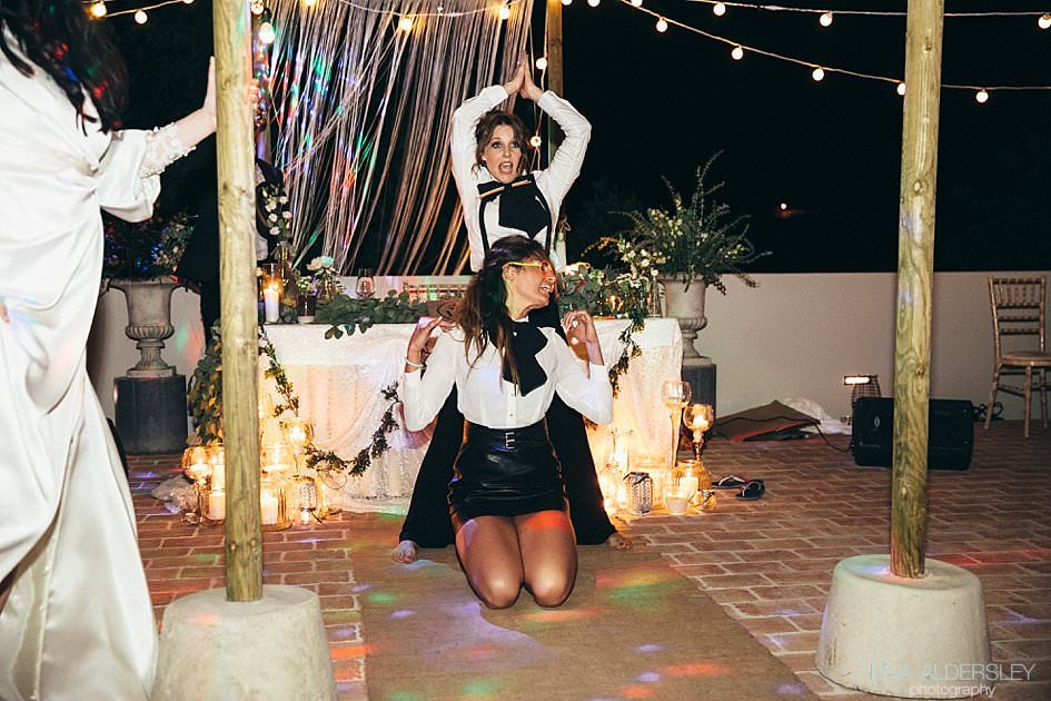 Bridemaids dancing at the wedding reception