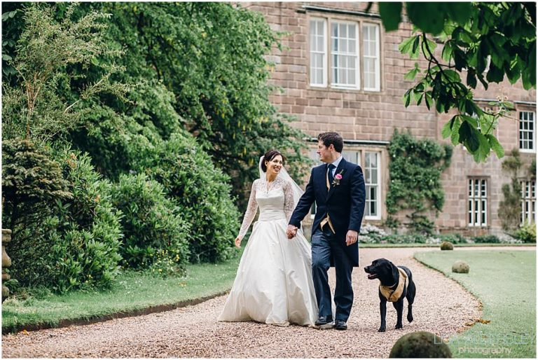 Bride and groom and their dog at a wedding at Browsholme Hall