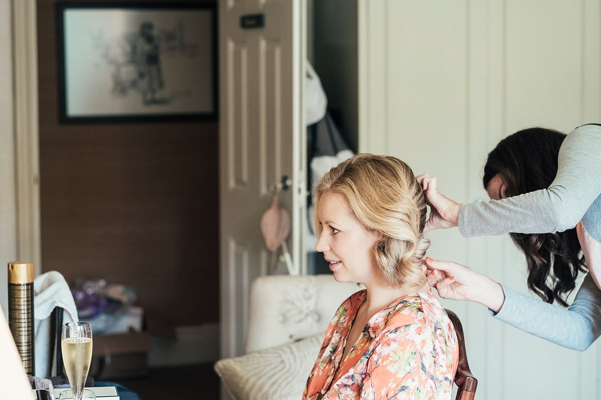 Bride getting hair done at a Gilpin Lake House wedding