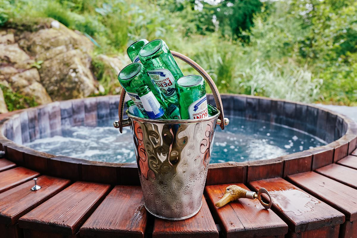 Empty peroni bottles by a hot tub