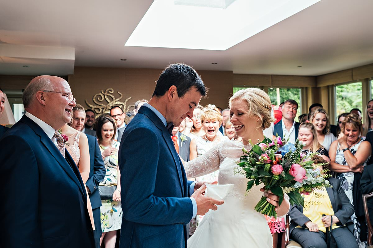 Bride and groom laughing and crying
