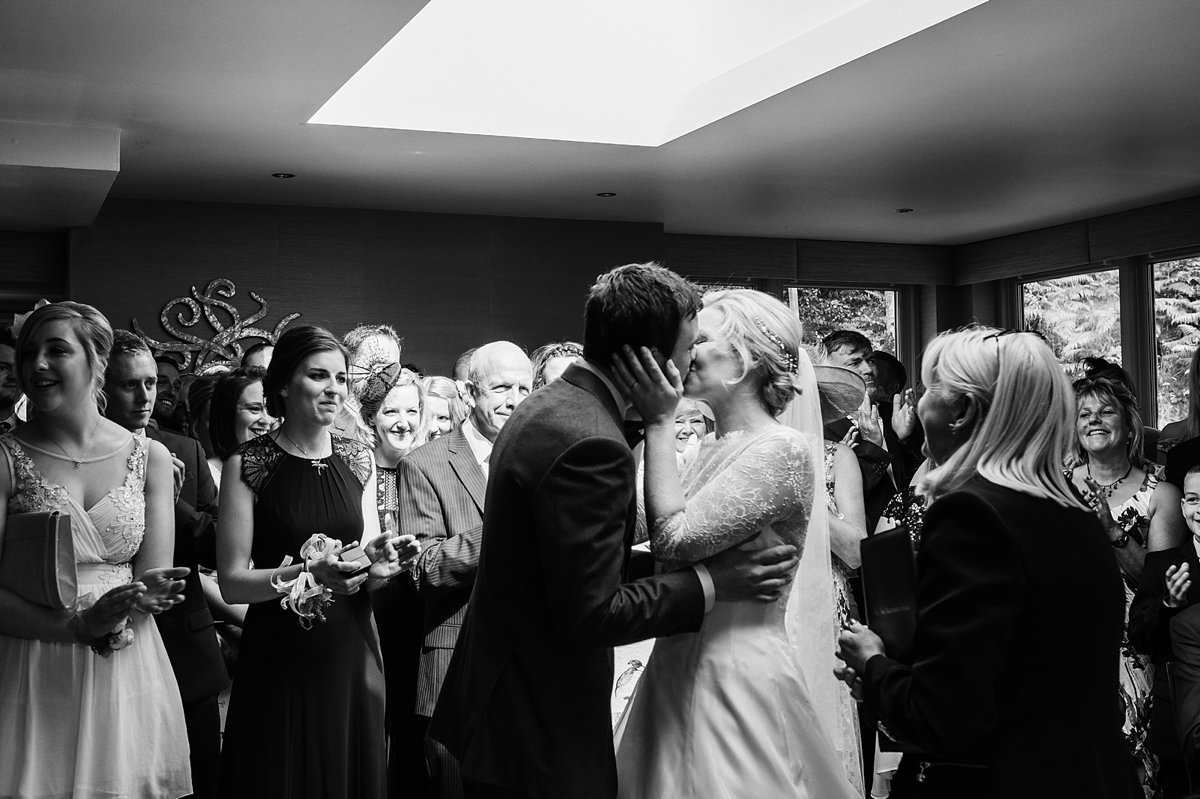 Bride and groom's first kiss as they are husband and wife