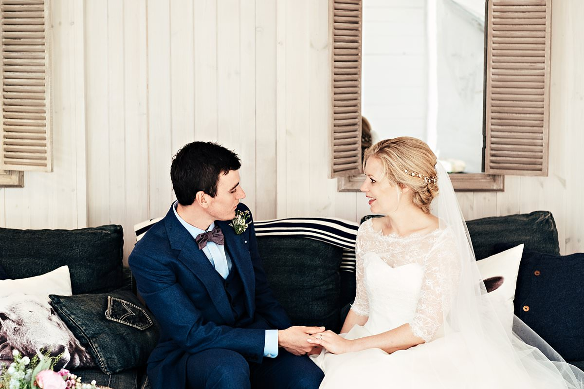 Bride and groom in Gilpin Lakes House's boat house