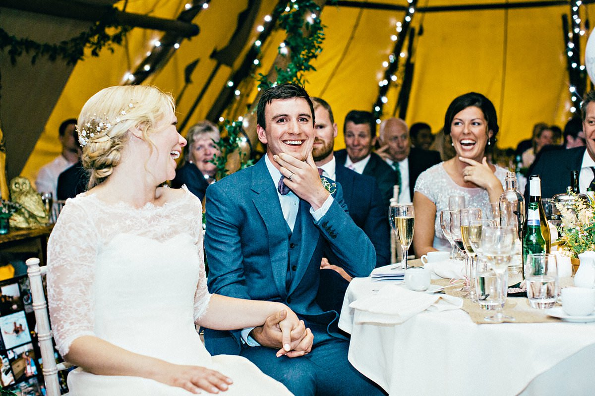 Groom laughing during the speeches