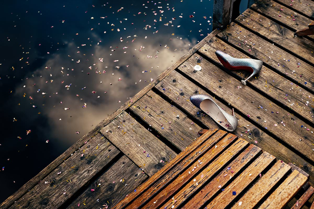 Christian Louboutin wedding shoes discarded on the jetty